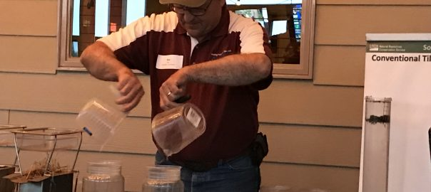 Stan Boltz demonstrating infiltration with jars of soil