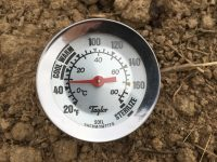 photo of a thermometer in bare soil